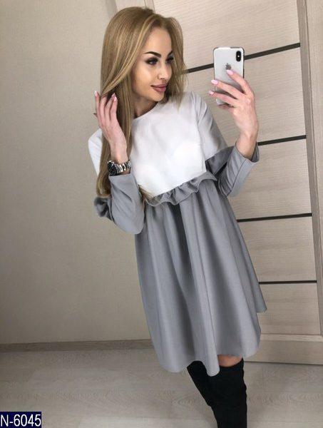 расклешенное серое платье