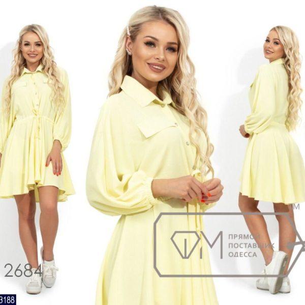 Легкое расклешенное платье с длинными рукавами